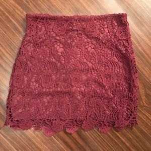 Maroon lace detail mini skirt by H&M. Size 6